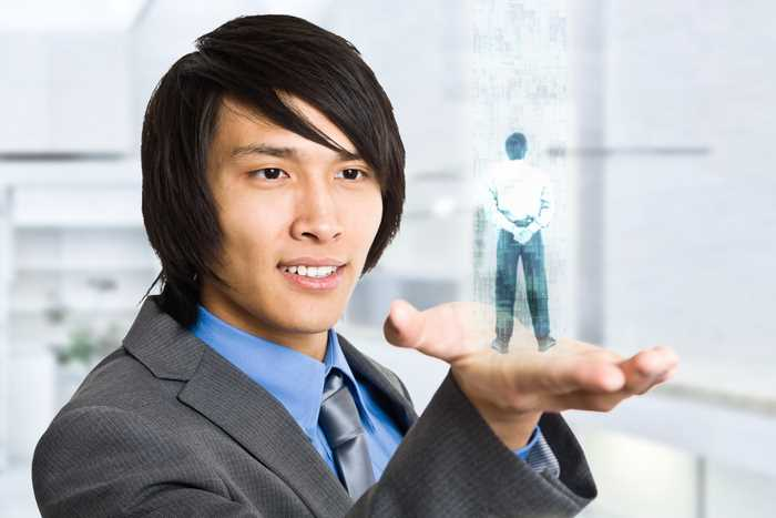 Businessman holding an hologram in his hand